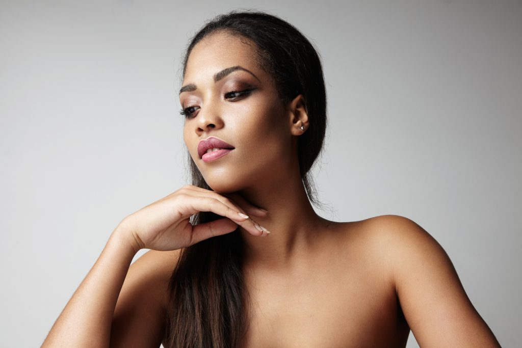 black woman with a long straight hair and ideal skin